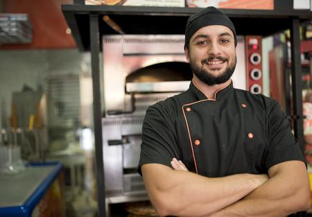 Turkish man posing near to oven