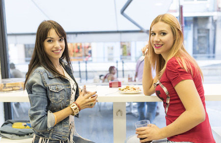 ambient: friends in bar two girls drinking in restaurant with ambient light Stock Photo