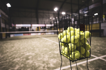 sport object: Paddle tennis basket in court with balls. Stock Photo