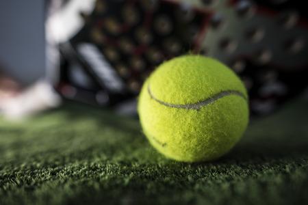Paddle tennis macro wide angle image of racket and ball