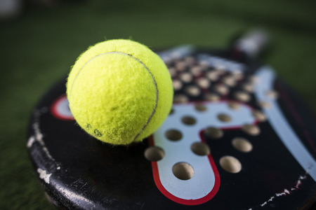sport object: Paddle tennis macro wide angle image of racket and ball