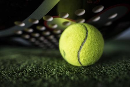 ''wide angle'': Paddle tennis macro wide angle image of racket and ball