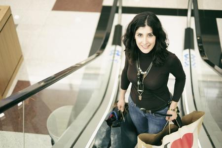 rebates: Woman shopping with fashion clothes bag