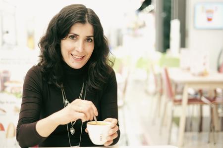 woman in bar terrace eating ice cream Stock Photo