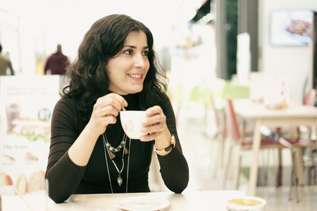 rebates: woman in bar terrace eating ice cream Stock Photo