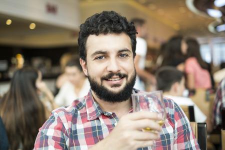 Bearded blue eyed man in restaurant  photo