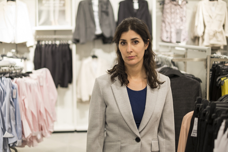 Woman buying clothes in mall photo