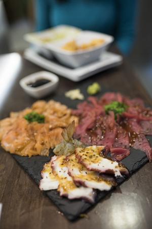 Sashimi food raw fish on modern Slate stone dish photo