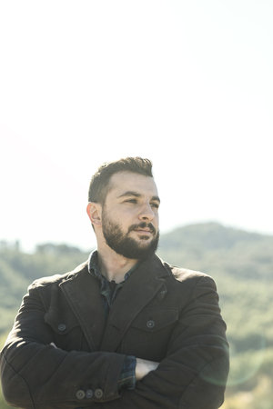 Bearded man posing in portrait with lens flare