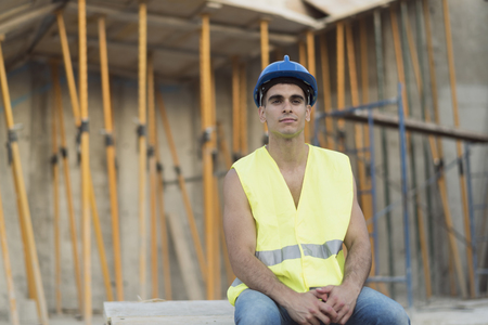 Young constructions worker having a rest in construction site