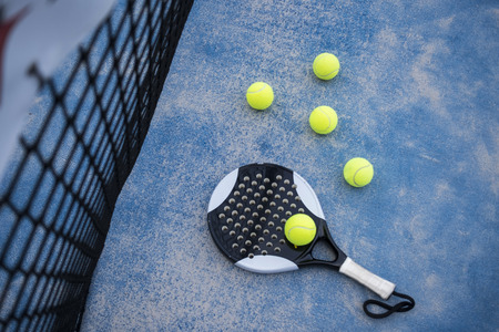 Paddle tennis racket and balls on court artificial grass Banque d'images