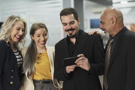 Group of worker looking phone in a job break