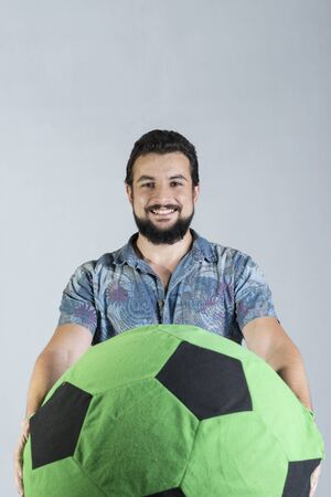 man with giant soccer ball