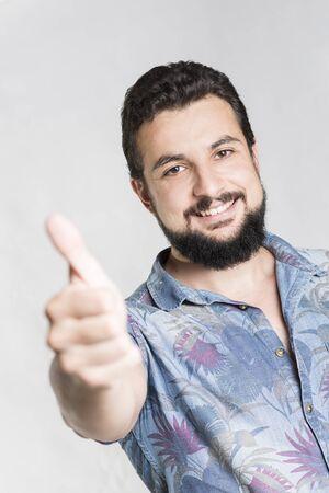 smiling bearded handsome man doing ok symbol at camera