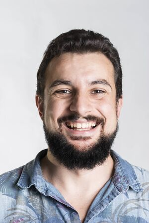 bearded man portrait smiling and looking at camera Stock Photo