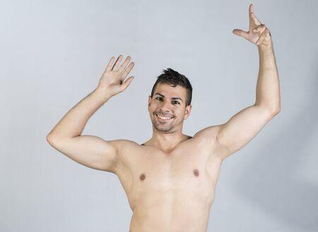 studio shot of shirtless young man