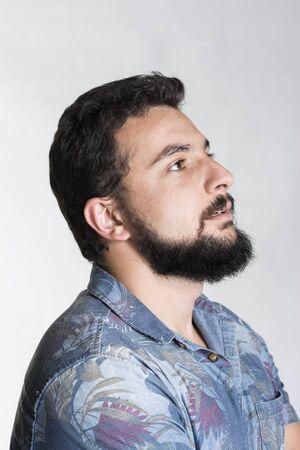 bearded man profile in studio shot looking up, Hawaiian