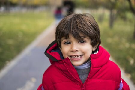 little kid looking at camera in outdoors park