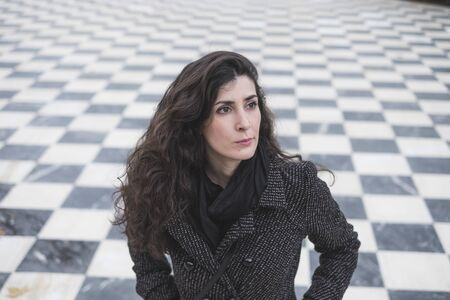 Pretty woman portrait in chess floor