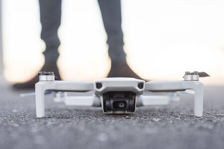 Drone in floor off, legs of men in background