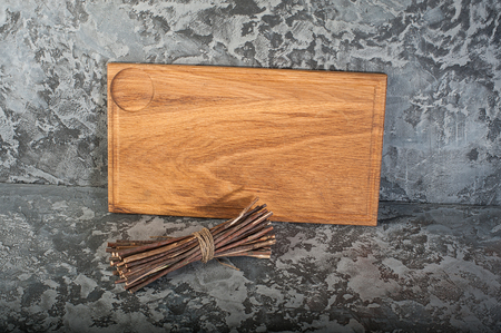 Gray concrete stone background texture with cutting board.