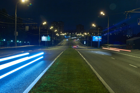 Lighting trails from traffic on the city road at night