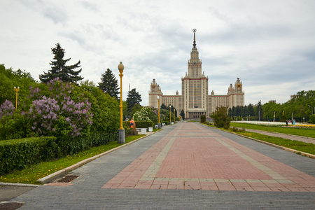 Main building of Moscow State University at the background and garden at foreground Editorial