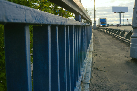 Blue fence on the bridge closeup