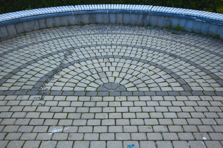 pattern paving slabs in the form of a circle Фото со стока