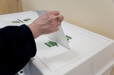 local election: MOSCOW, RUSSIA - DECEMBER 4: Woman put election ballot with candidates of parties to the State Duma of Russian Federation into the box on December 4, 2011 in the local election commission. Editorial
