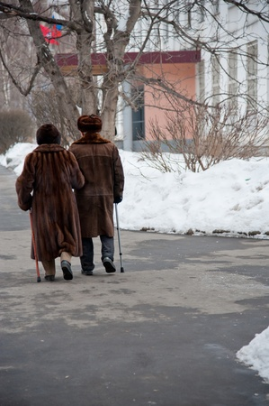 local election: MOSCOW, RUSSIA - MARCH 4: Old couple going to election of Russian President on March 4, 2012 in the local election commission.