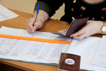 local election: MOSCOW, RUSSIA - MARCH 4: Woman write name of voters in notebook on election of Russian President on March 4, 2012 in the local election commission. Editorial