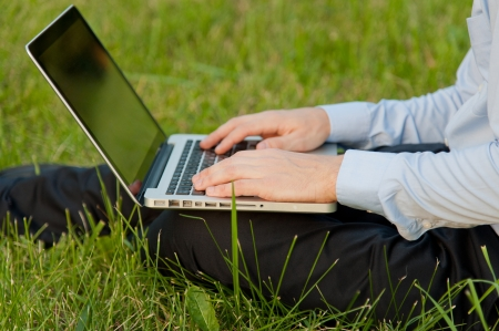 Businessman with notebook writes on the keyboard photo
