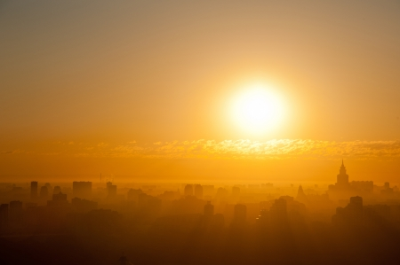 Sunrise at the city. Silhouette of buildings. Stock Photo - 14557545