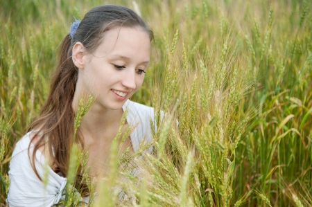 Beautiful woman smiles in the wheat field Stock Photo - 14566966