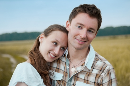 Portrait of beautiful couple in the meadow photo