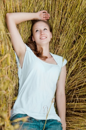 Portrait of beautiful smiling woman in the wheat field Stock Photo - 14962223