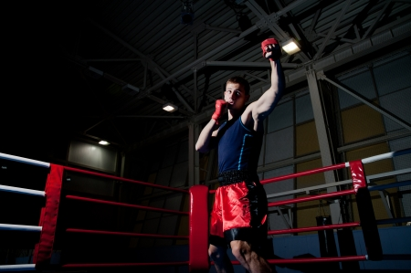 ring stand: Young adult man boxing in gym  Stock Photo