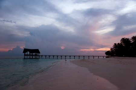 Beautiful jetty over the indian ocean at the sunset photo