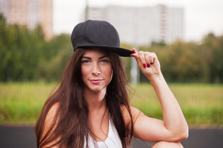 Portrait Of Sexy Woman With Cap On Sport Playground Stock Photo - 23522708