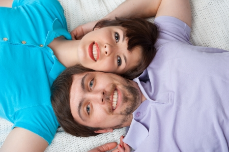 Cropped view of a young couple lying in bed and looking up photo