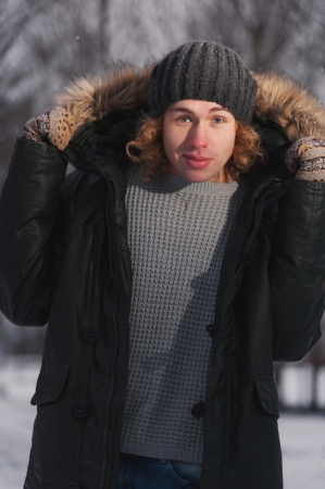 Portrait of young smiling man in the Park at winter photo
