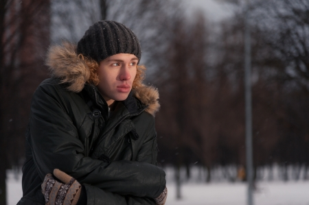 Portrait of young thoughtful man in the Park at winter photo