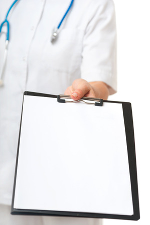 Closeup shot of woman doctor showing blank clipboard to write it on your personal message or advice on white background photo