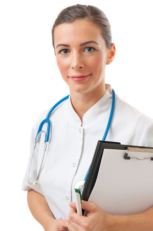 Portrait of caucasian attractive thoughtful smiling doctor female holding clipboard and pen. Isolated shot of doctor woman with brown hair with stethoscope on the neck photo