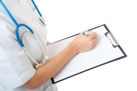 Portrait of Caucasian female doctor with blue stethoscope on neck writing on blank clipboard on white background. Isolated woman doctor in white medical gown Stock Photo - 25397940