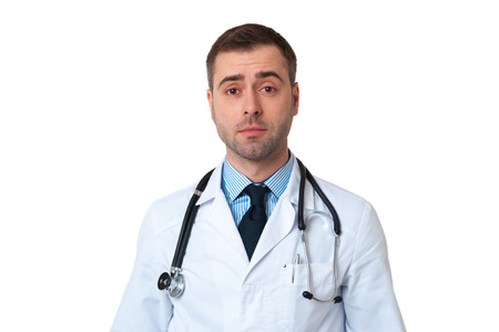 Smiling doctor man with stethoscope around his neck isolated on white background photo