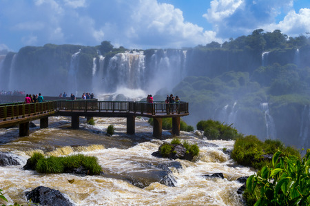 Iguazu Falls or Iguassu Falls in Brazil. Beautiful Cascade of waterfalls. Turists photo