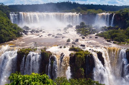 Iguazu Falls or Iguassu Falls in Brazil. Beautiful Cascade of waterfalls with clouds and jungle Zdjęcie Seryjne
