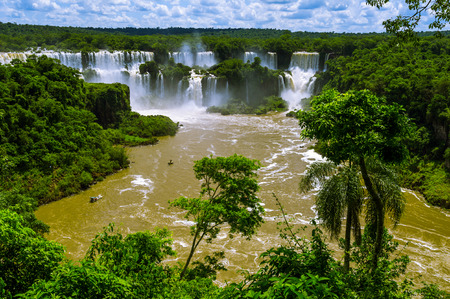 Iguazu Falls or Iguassu Falls in Brazil  Beautiful Cascade of waterfalls in jungle with river view photo